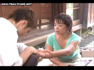 japanese lady is licking husbands dick before he