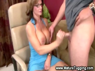 mature babe massaging a cock