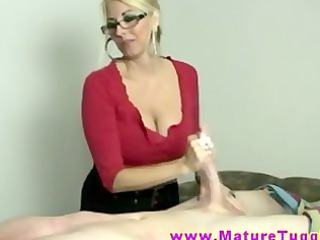 blond woman wipes penis with her hands