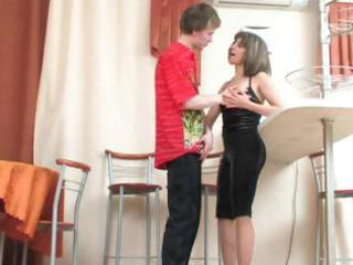busty brunette mom surprises a young stud with a