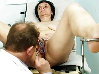 elderly brunette old obtains her elderly vagina