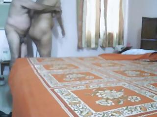 older  indian pair making adore inside bedroom
