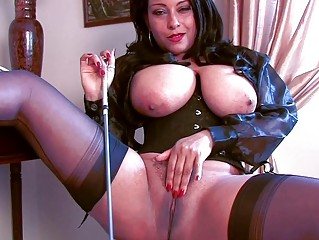arousing brunette momma inside corset and nylons