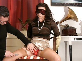 woman into satiny nylons obtains blindfolded