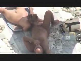 cougar duo caught piercing on beach by voyeur spy
