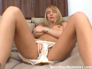 older babe with huge tits plays