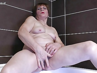 fresh grandma dildoing into the bathroom