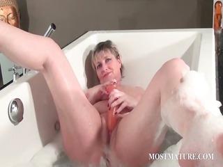 filthy older  pleases into bathtub