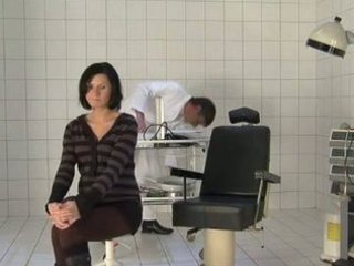 medic fukcs pregnant woman during check up visit.