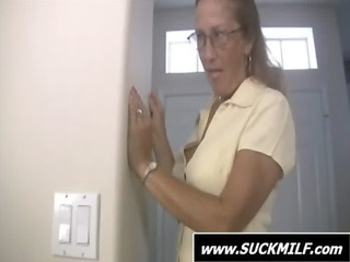 milf into glasses gives dick sucking on the bed